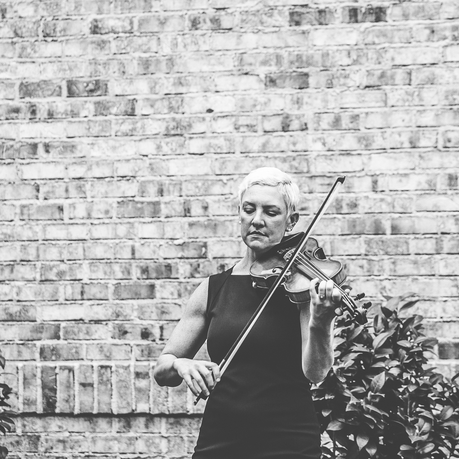 Black and white of Maura and her violin